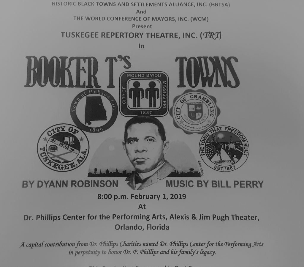 """Program for Tuskegee Repertory Theatre's presentation of """"Booker T.'s Towns by Dyann Robinson,"""" featuring a central image of Booker T. Washington surrounded by the crests of five historically Black Southern towns: Tuskegee, AL, Hobson City, AL, Mound Bayou, Mississippi, Grambling, LA, and Eatonville, FL"""