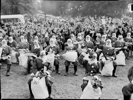 Santas and crowd, probably at Wilmington, NC's Hilton Park, circa late 1940s