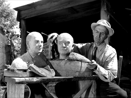John Weaver carving busts for the USS NC Museum, early 1960s
