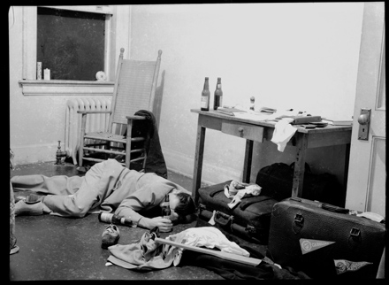 UNC-Chapel Hill student who appears to be passed out in his dorm room after a night of drinking beer, ca. 1940-1942