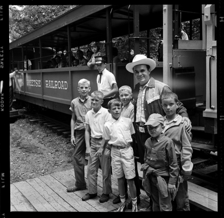 Fred Kirby as the Tweetsie Marshal posing with boys including Jim Morton, July 1959