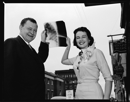 Grady Cole (L) and unidentified woman holding up an X-ray, Wilmington, NC, ca. early 1950s