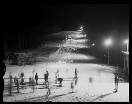 Long exposure of skiers on ski slope near Boone, NC, ca. 1970s