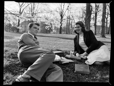 Couple lounging on grass, UNC-Chapel Hill, early 1940s