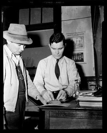 Accused/arrested Klansman being fingerprinted, Columbus County NC, Feb. 1952