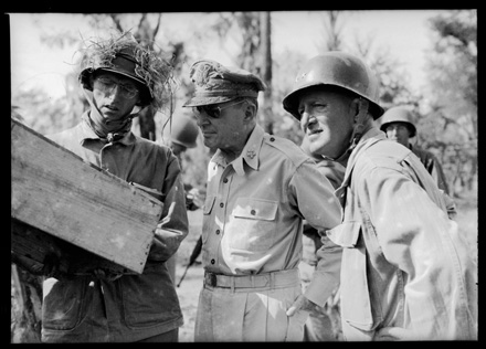 General Douglas MacArthur conferring with field officers, Luzon, Philippines, January 1945