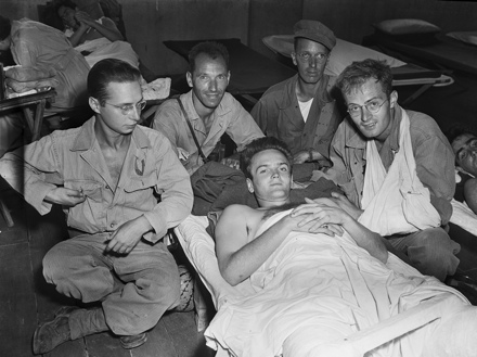 Hugh Morton (right, arm in sling) wounded, with photo team, March 1945