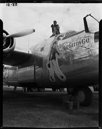 "Hugh Morton with movie camera atop plane ""Go Gettin' Gal,"" World War II, early 1940s"