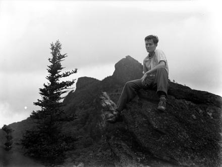 Hugh Morton in front of Grandfather Mountain peaks, circa 1940s