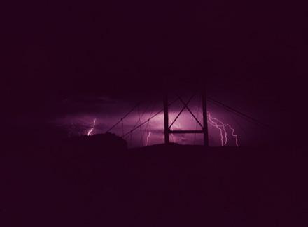 Mile High Swinging Bridge in lightning storm, circa 1950s