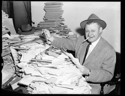 WBT Radio's Grady Cole at desk, early 1950s