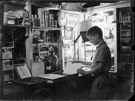 Boy developing prints in Camp Yonahnoka darkroom?, early 1940s