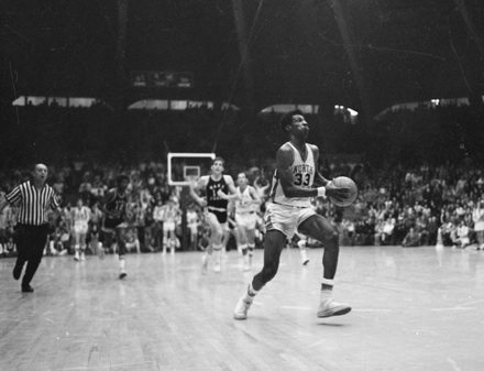 UNC's Charles Scott (33) on a fast break against Wake Forest, late 1960s