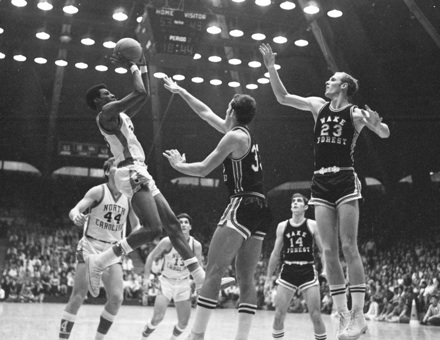 UNC's Charles Scott (33) puts up a shot against Wake Forest, late 1960s