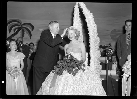 NC Governor R. Gregg Cherry crowning the first Azalea Queen, Jacqueline White, in 1948