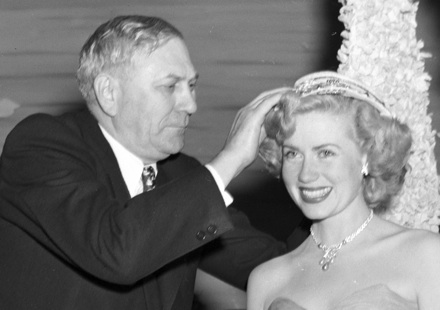 NC Governor R. Gregg Cherry crowning the first Azalea Festival Queen, Jacqueline White, in 1948