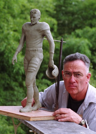 Johnpaul Harris with model of Charlie Justice statue, ca. 2004.