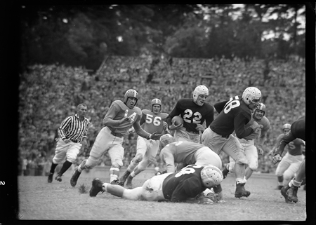 Charlie Justice running football versus Tennessee, 1947