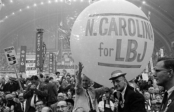 Supporters of Lyndon Baines Johnson holding a large balloon at 1964 Democratic National Convention.