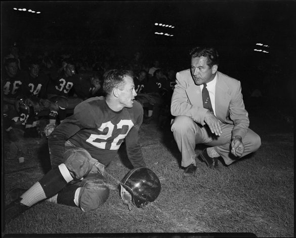"Charlie ""Choo Choo"" Justice on sidelines with Washington Redskins head coach Joe Kuharich"