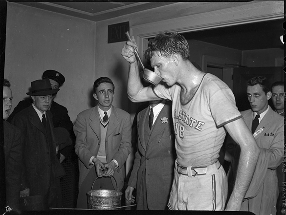 """Horace """"Bones"""" McKinney drinking from a ladle at the 1942 Southern Conference Tournament"""