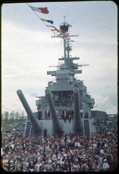 Crowd onboard USS North Carolina during memorial dedication