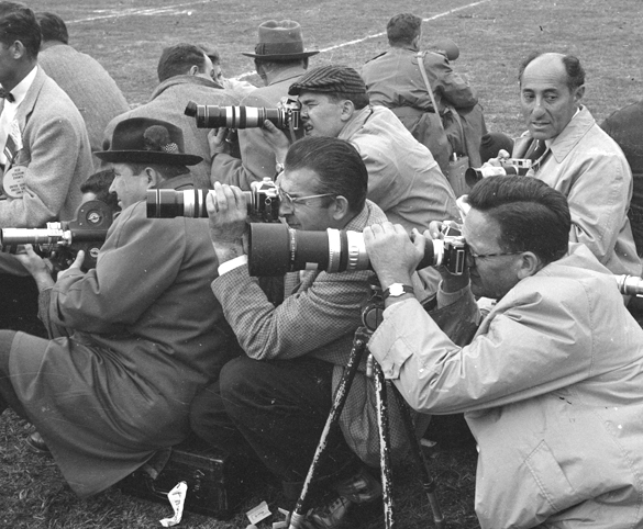 Photographers at UNC vs Maryland football game, 1957