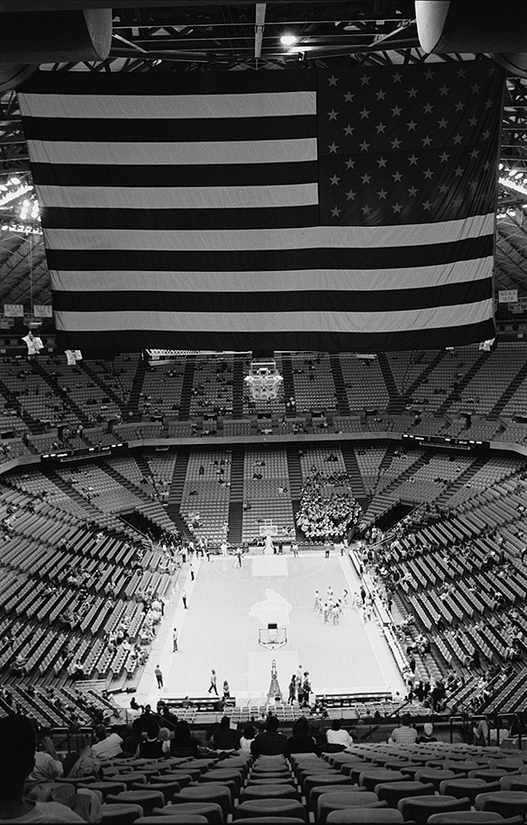 American flag hanging from rafters of Dean Smith Center.
