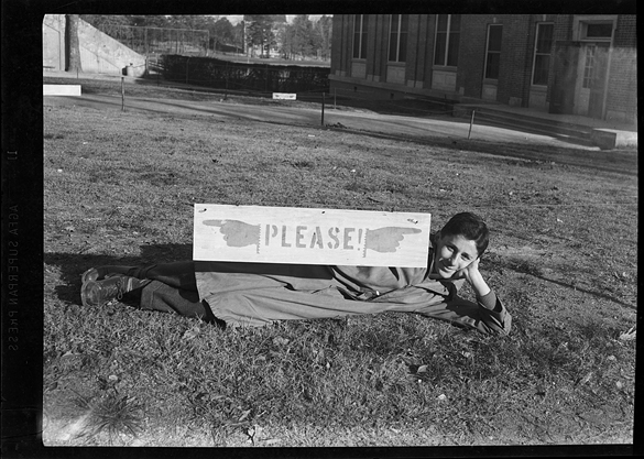"Gene Witten with ""please"" sign"