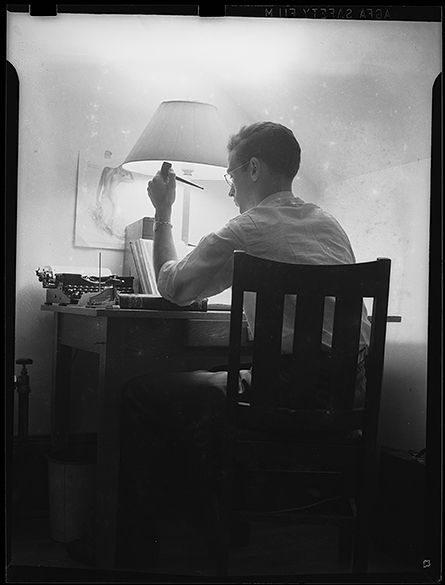 UNC student studying while holding a pipe.