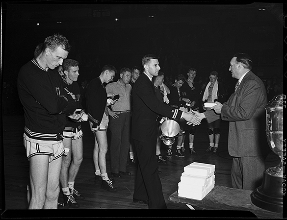 1946 UNC coach Ben Carnevale receiving runner-up trophy
