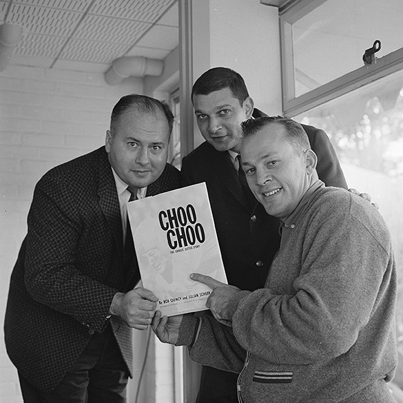 Bob Quincy, Julian Scheer, and Charlie Justice with copy of CHOO CHOO: THE CHARLIE JUSTICE STORY, circa September 1958.