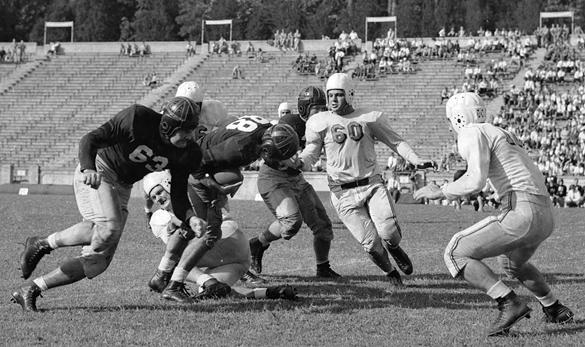 Al Grygo, University of South Carolina halfback, running during game with University of North Carolina..