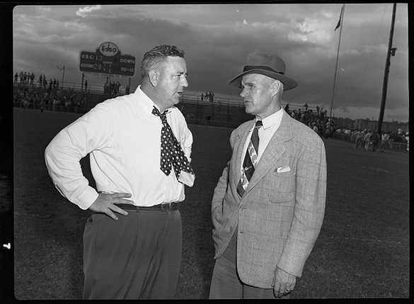 Rex Enright of University of South Carolina and Carl Snavely of the University of North Carolina meet after UNC's 28-13 victory on October 8, 1949 at Columbia, S.C.