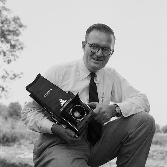 1950s portrait of photographer Hugh Morton with Graflex camera.