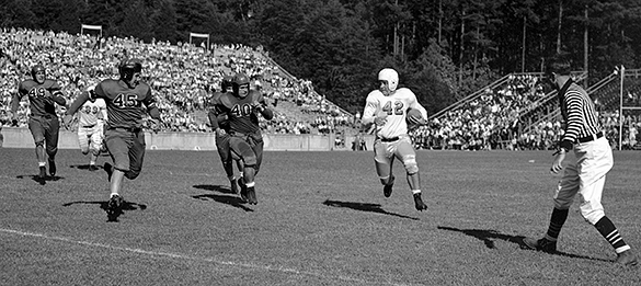 UNC's Bob Mitten (#42 with ball); #45 Virginia quarterback Edward Mifflin; and #40 Virginia left halfback Henry Woodward, December 1, 1945 at UNC-Chapel Hill's Kenan Stadium.