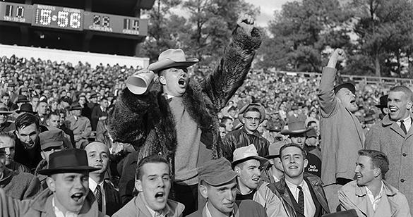 Fans cheering at UNC-Chapel Hill football game versus University of Virginia at Kenan Memorial Stadium, Chapel Hill, N.C., November 19, 1955.