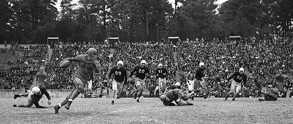 University of Virginia's Bill Dudley (#35) touchdown run during the UNC-UVA football game at Kenan Stadium, November 20, 1941.