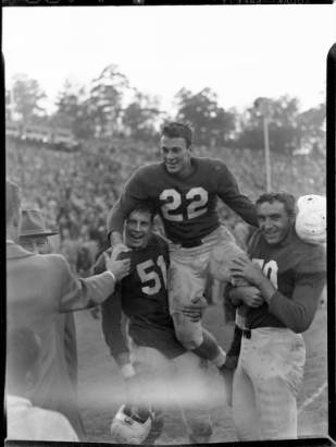 "Charlie ""Choo Choo"" Justice (#22) being carried by his teammates, UNC-Chapel Hill versus Duke University football game, at Kenan Memorial Stadium, Chapel Hill, N.C., November 23, 1946."