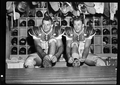 UNC fullback Walt Pupa (L) and UNC Tailback Charlie Justice in the locker room at Griffith Stadium, Washington DC.