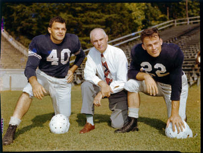 "L to R: UNC Tar Heels football player Walt Pupa, UNC head football coach Carl Snavely, and UNC player Charlie ""Choo Choo"" Justice, most likely photographed in 1947 during the preseason in Kenan Memorial Stadium, Chapel Hill, NC."