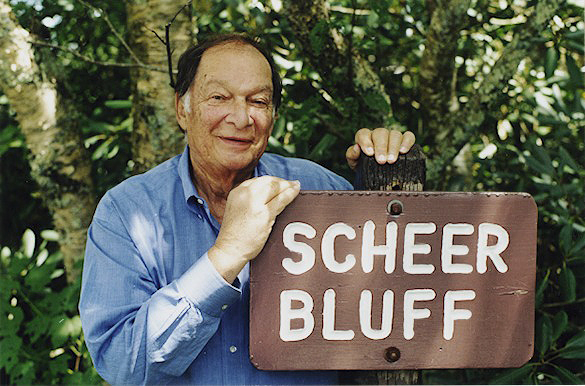 Julian Scheer posed next to Scheer Bluff sign