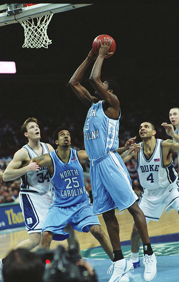 Jackie Manuel (UNC, #5) shooting during the quarterfinals of 2002 ACC basketball tournament, UNC-Chapel Hill versus Duke University basketball game, Charlotte Coliseum, NC. Jason Capel (UNC, #25) boxes out Duke's Mike Dunleavy (#34), while Carlos Boozer (#4) awaits a possible rebound. Duke won 60 to 48.  Boozer and Dunleavy are currently teammates and active players for the Chicago Bulls in the National Basketball Association.
