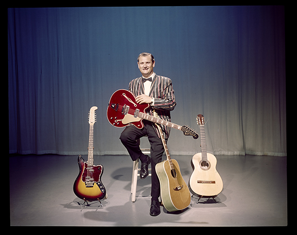 "Arthur Smith posing for album cover portrait for ""The Guitars of Arthur 'Guitar Boogie' Smith"", circa 1968."