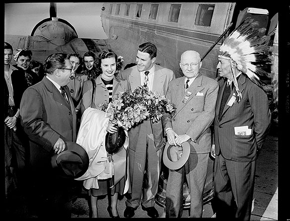 "Hal Love, president of the Azalea Festival Committee; Mrs. Norma Walker; Doak Walker; former Wilmington mayor E. L. White; and Cherokee leader McKinley Ross (with ""Unto These Hills"" program in pocket) at Bluethenthal Airport, Wilmington N. C., 31 March 1950."