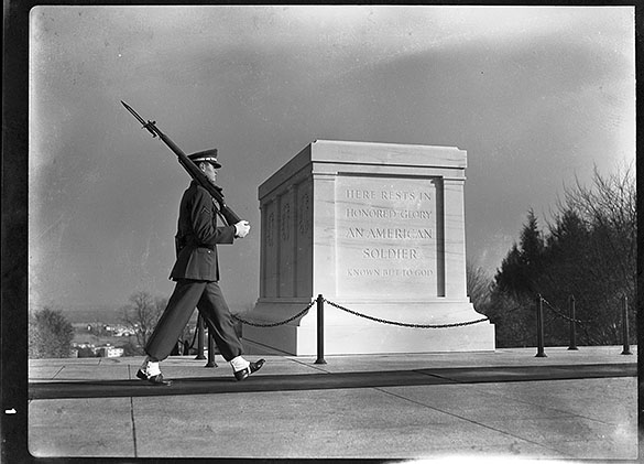 Tomb of Unknown Soldier monument, with guard, at Arlington National Cemetery, Arlington, Virginia, circa late 1930s or early 1940s.