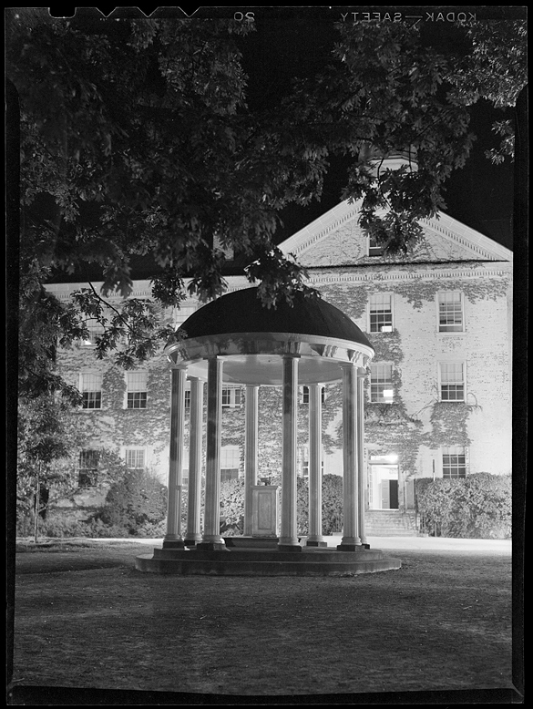 "With the title caption ""A New 'Shot' of the Old Well and South Building"" in the October 1946 issue of The Alumni Review, this is Hugh Morton's first UNC scene published in that magazine after WWII—with the columns vertically straightened, its edges cropped on all sides for publication, and accompanied by a long caption about Morton war service. This scan shows the entire negative. This was also on the magazine cover of The State for its October 5th issue, cropped even more tightly at the base of the well to accommodate the magazine's masthead."