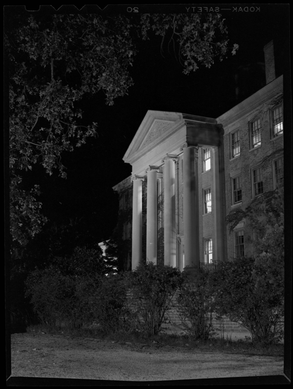 "This night photograph of South Building appeared in the November 1946 issue of The Alumni Review with the caption title ""Columns of South."" The caption writer described this photograph as being ""symbolic of the University--old and new"" showing ""the 'new' side, looking south toward the area of greatest physical expansion of the campus in the years since the building period of the 'Twenties."""
