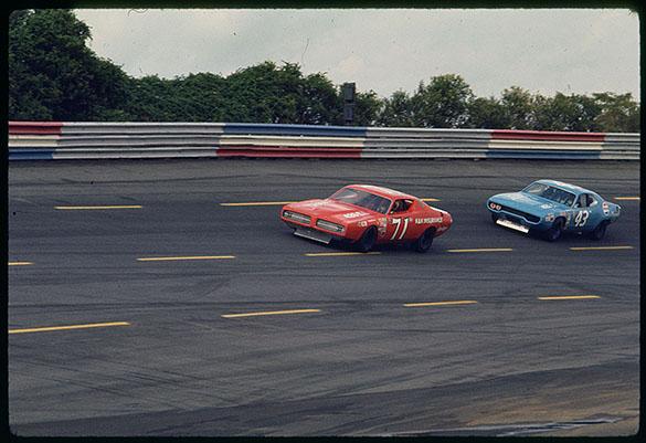 Car #71 (K & K Insurance Dodge) driven by Bobby Isaac and Car #43 (Petty Enterprises Plymouth) driven by Richard Petty.