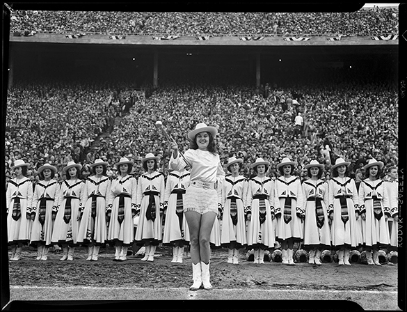 The Apache Belles majorettes from Tyler, Texas during the 1950 Cotton Bowl festivities.  A caption in the Greensboro News identified the majorette as Iwanna Burk, sister of Baylor star quarterback Adrian Burk.